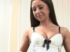 Brunette with sexy underclothes uses a dildo in her autonomy