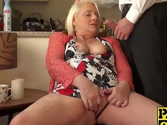 British mature blonde granny Carol fingers her soaking pussy