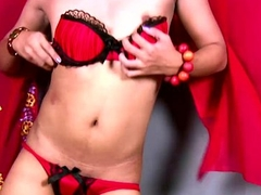 Ladyboy in red lingerie performs striptease with an increment of masturbation