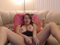Chubby blonde shows her conscientious tits and puts a dildo inside her