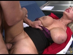 Holly Brooks uses her tits to calm her patient down