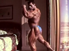 Huge Bodybuilder Flexing in Hotel Room