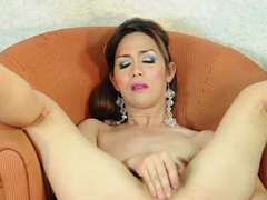 Oriental ladyboy toying her ass with dildo